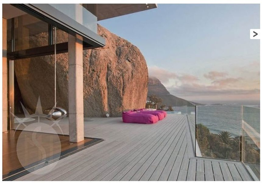 The glass-fronted Icehouse a property in Llandudno Cape Town often used as film location