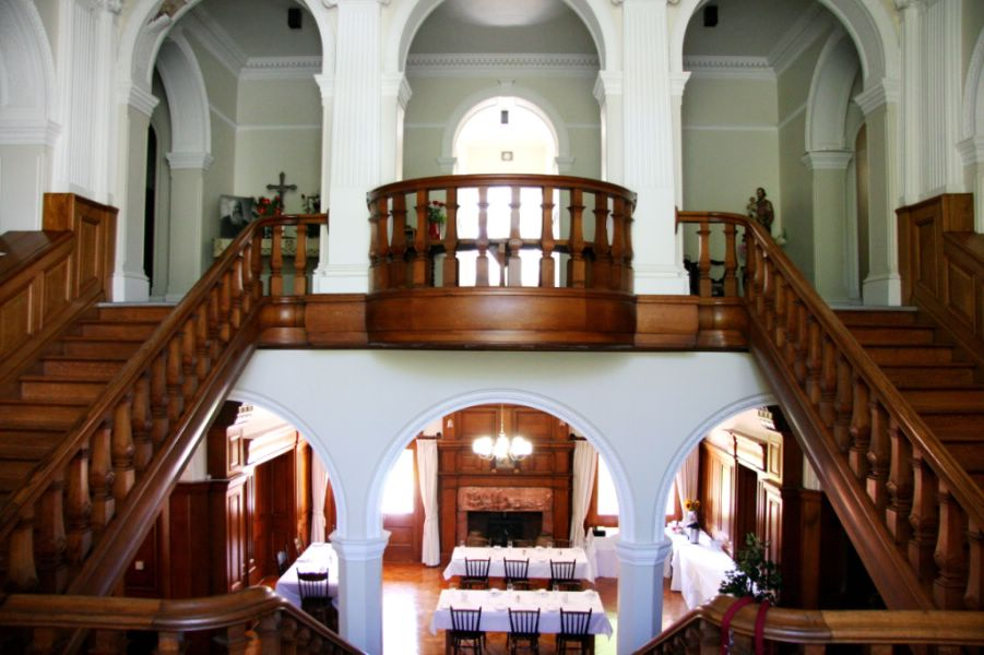 Wooden staircase inside heritage building at Schoenstatt Estate and Conference Centre